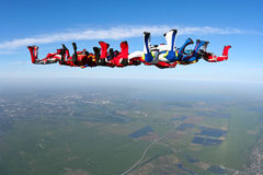 Skydiving photo. Several paratroopers do sports in a free fall jump stock image