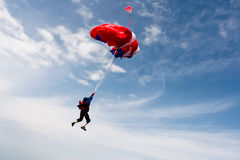 Skydiving photo. Sports skydiver opens the parachute stock photography
