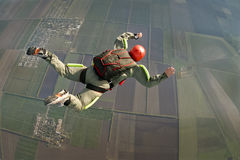 Skydiving photo. Student skydiver executes a jump in free fall royalty free stock photo