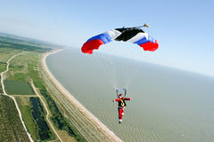 Skydiving photo. Sports skydiver parachute pilots, landing stock image