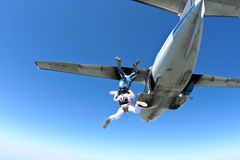 Skydiving photo. Two parachute jump from an airplane royalty free stock photo
