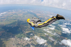 Skydiving photo. Student skydiver executes a jump in free fall stock photo
