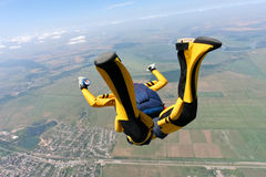 Skydiving photo. Student skydiver executes a jump in free fall stock images
