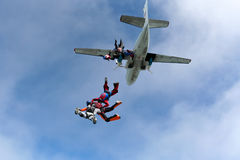 Skydiving photo. Several paratroopers do sports in a free fall jump royalty free stock photography