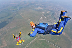 Skydiving photo. Sports parachutist videographer shoots of falling student parachutist royalty free stock image