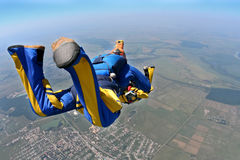 Skydiving photo. Sports parachutist videographer shoots of falling student parachutist royalty free stock photos