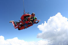 Skydiving photo. Sport Tandem jump, free fall stock photo