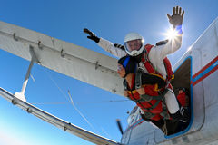 Skydiving photo. Sport Tandem jump,separation from the aircraft stock images