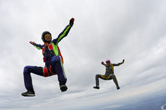 Skydiving photo. Two girls in free fall stock photos