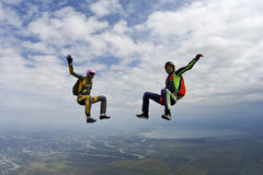 Skydiving photo. Two girls in free fall royalty free stock photography