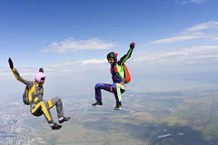Skydiving photo. Two girls in free fall stock image
