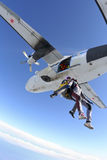 Skydiving photo. A girl and a guy jump out of an airplane stock photos