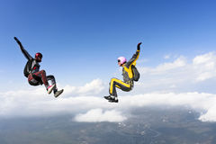 Skydiving photo. A girl and a guy in a free fall stock images
