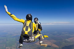 Skydiving photo. Two girls building a figure in a free fall stock photo