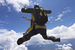 Skydiving photo. The free fall in the clouds stock photos