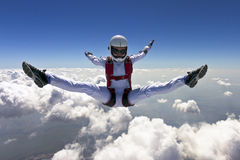 Skydiving photo. A girl performs in a free fall free style royalty free stock photo