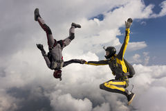 Skydiving photo. Boy and girl in free fall royalty free stock images