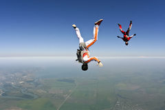 Skydiving photo. Skydivers in freefall build a figure royalty free stock photos
