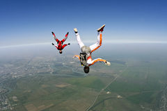 Skydiving photo. Skydivers in freefall build a figure royalty free stock images