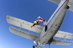 Skydiving photo. A student parachutist jumps from an airplane stock image