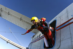 Skydiving photo. A student parachutist jumps from an airplane stock images