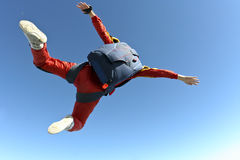 Skydiving photo. The student performs the task parachutist in free fall royalty free stock photography