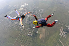 Skydiving photo. The student performs the task parachutist in free fall under the supervision of an instructor stock image