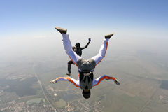 Skydiving photo. Skydivers in freefall build a figure stock photos