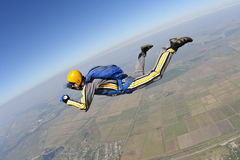 Skydiving photo. The student performs the task skydiver in freefall royalty free stock images