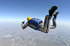 Skydiving photo. A jumper rotates around its own axis stock photo