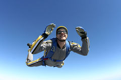 Skydiving photo. A jumper in the classic pose of free fall royalty free stock image