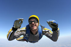 Skydiving photo. The student performs the task skydiver in freefall royalty free stock photography
