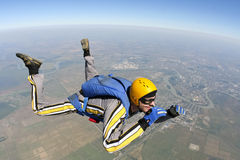 Skydiving photo. The student performs the task skydiver in freefall royalty free stock photos