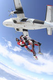 Skydiving photo. Two sports parachutist jumping from a plane stock photography