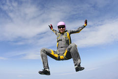 Skydiving photo. Female skydiver does fall sitting royalty free stock image