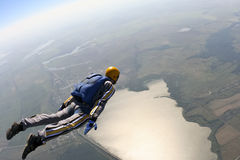Skydiving photo. The student skydiver is moving along the horizon stock images