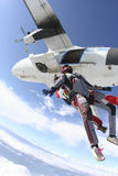 Skydiving photo. Two sports parachutist jumping from a plane royalty free stock photos