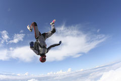 Skydiving photo. Skydiver does fall headfirst royalty free stock images