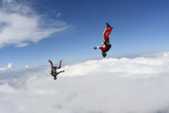 Skydiving photo. Two skydivers do fall headfirst stock photo