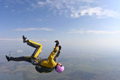 Skydiving photo. Female skydiver does fall back down stock image