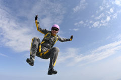 Skydiving photo. Female skydiver does fall sitting stock photos