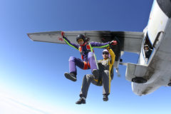 Skydiving photo. Two girls skydivers jump out of an airplane royalty free stock photo