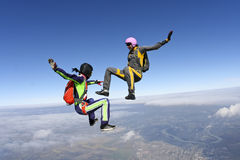 Skydiving photo. Two girls skydivers building freefall in the figure royalty free stock photography