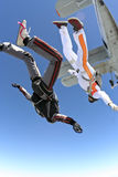 Skydiving photo. Two parachute jump from an airplane stock photo