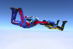Skydiving photo. Two parachutists construct figures in free fall stock images