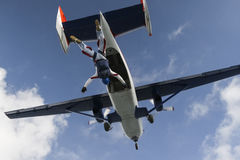 Skydiving photo. Student skydiver jumps out of an airplane stock photography