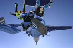 Skydiving photo. A group of paratroopers jumping out of the plane and build a figure royalty free stock images