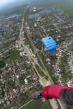 Skydiving photo. Parachute in the sky above the municipality royalty free stock photography