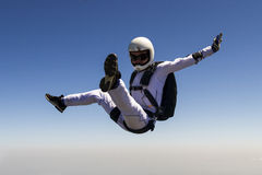 Skydiving photo. A girl performs in a free fall free style royalty free stock image