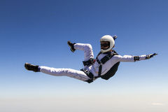 Skydiving photo. A girl performs in a free fall free style stock photography